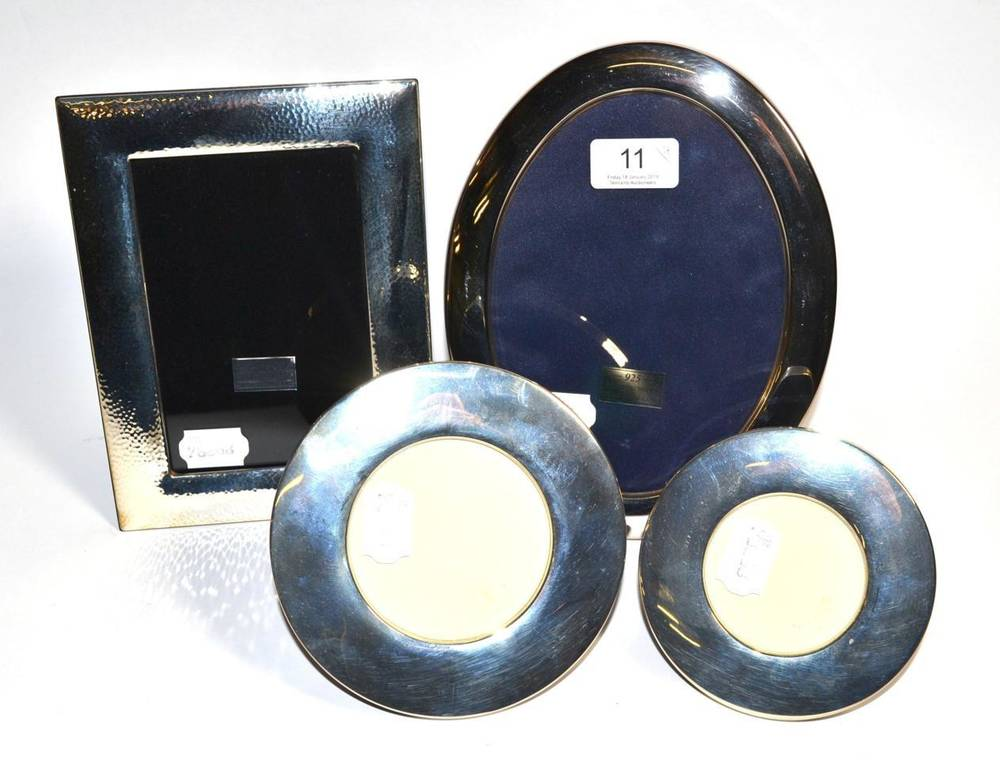 Lot 11 - Four modern silver photograph frames, one oval, two circular and one rectangular example with...
