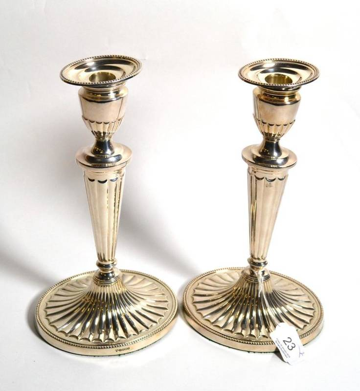 Lot 23 - A matched pair of George III style silver candlesticks, C J Vander Ltd, Sheffield, 1996 and...