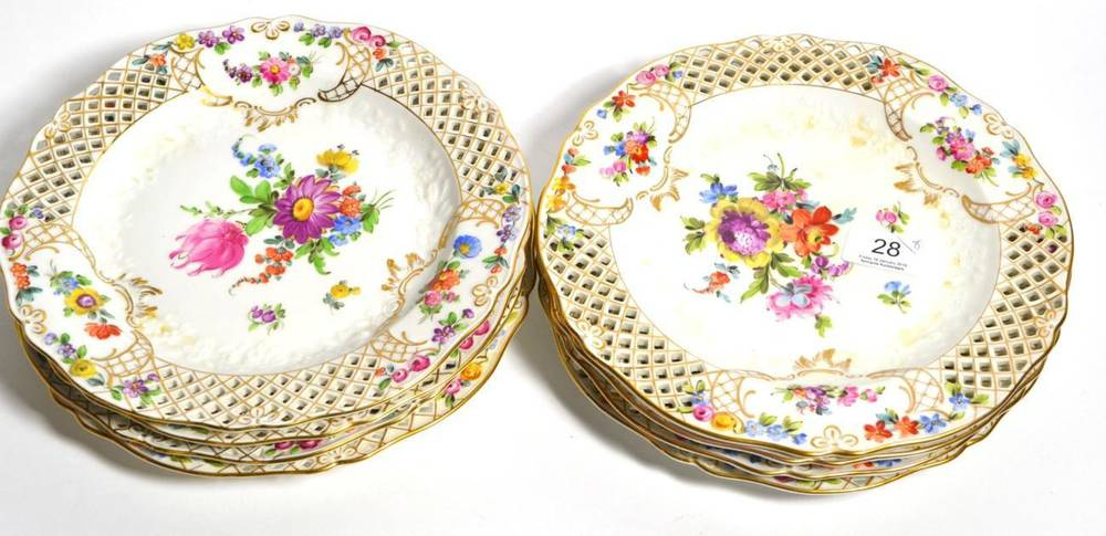 Lot 28 - Eight Dresden hand-painted floral plates with pierced rims