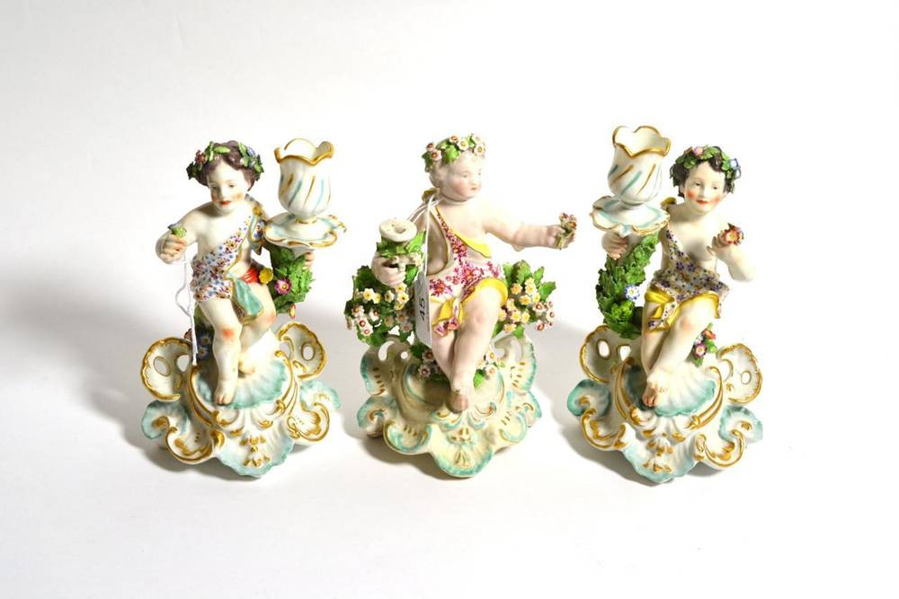 Lot 45 - A Derby porcelain figural chamberstick, circa 1775, modelled as a cherub sitting on a tree...