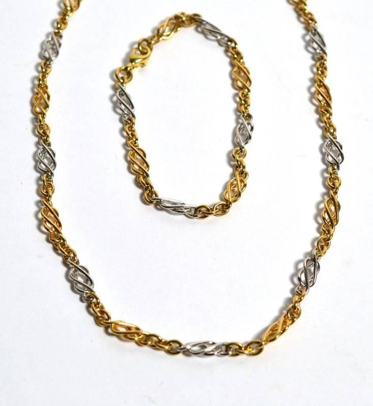 Lot 57 - A 9ct two coloured gold Celtic link necklace and bracelet set, 33g gross (2)