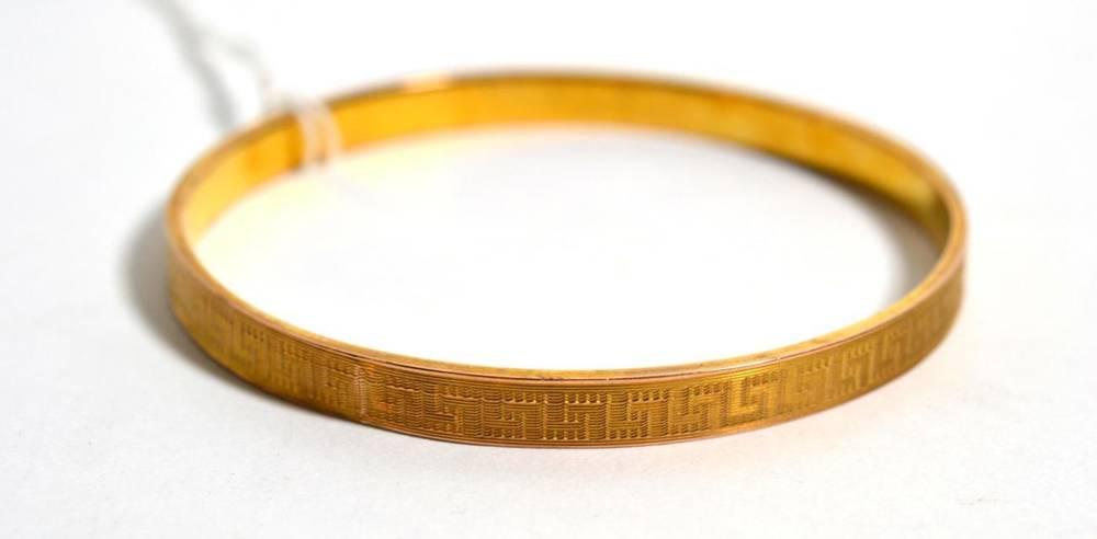 Lot 83 - A slave bangle, with greek-key motif, 11.8g, stamped '9'