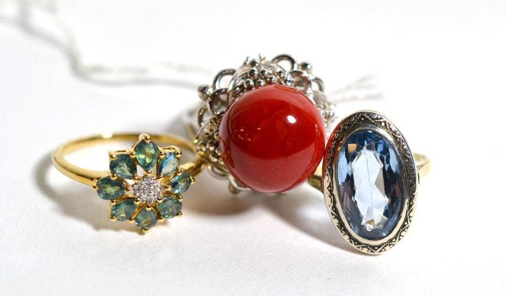 Lot 85 - A coral ring, finger size M, stamped '14K', 10.3g, a 9 carat gold emerald and diamond cluster...
