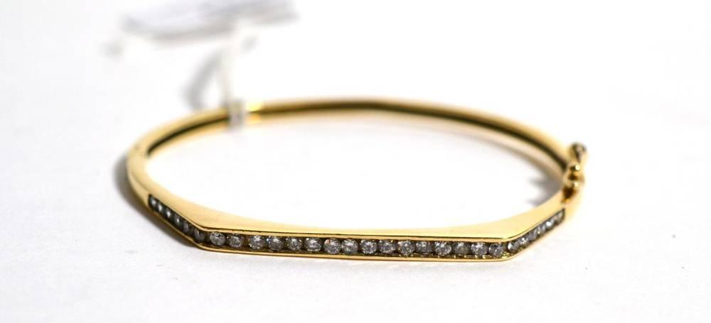 Lot 86 - A 9 carat gold paste set bangle, measures 5cm by 6cm, 11.3g