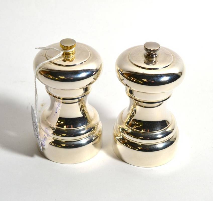 Lot 115 - A pair of modern silver salt and pepper grinders, Carrs, Sheffield 2005, 10cm high (2)