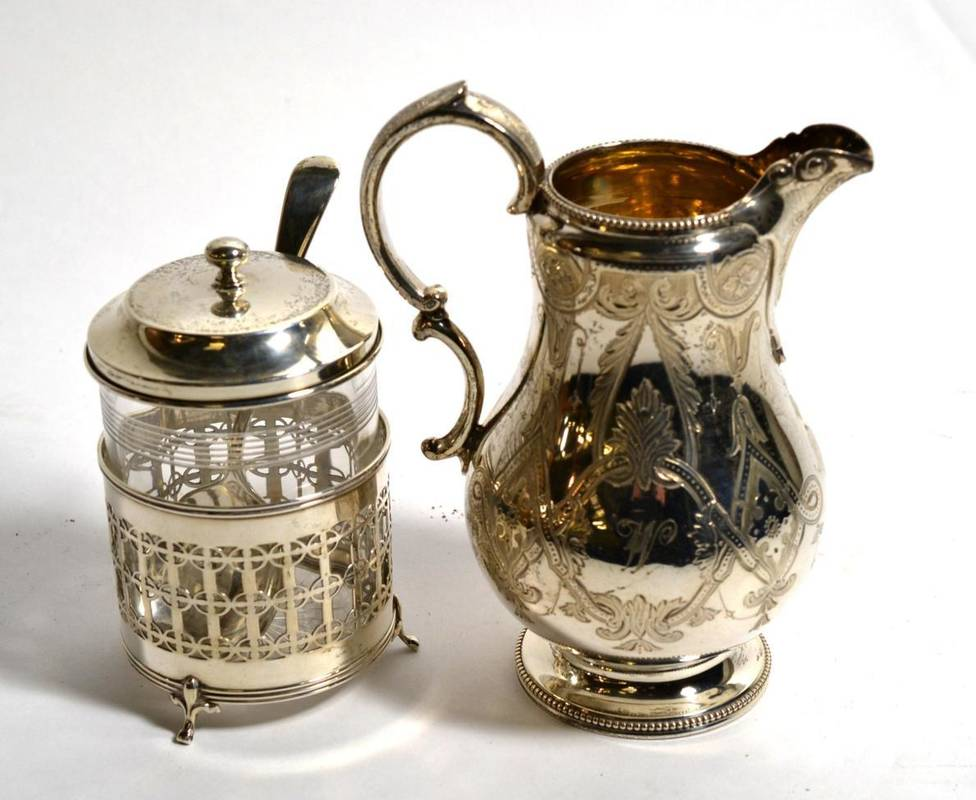 Lot 137 - A Victorian silver cream jug, George Richards & Edward Brown, London 1865, with engraved...