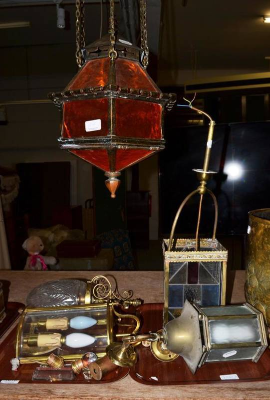 Lot 1010 - A middle Eastern style brass hanging lantern, a brass and coloured glass four-sided lantern,...