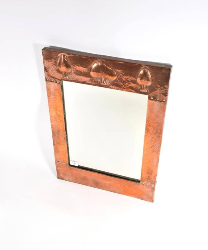 Lot 248 - A Liberty & Co. Ltd Copper Rectangular Wall Mirror, the top with stylised decoration, riveted...