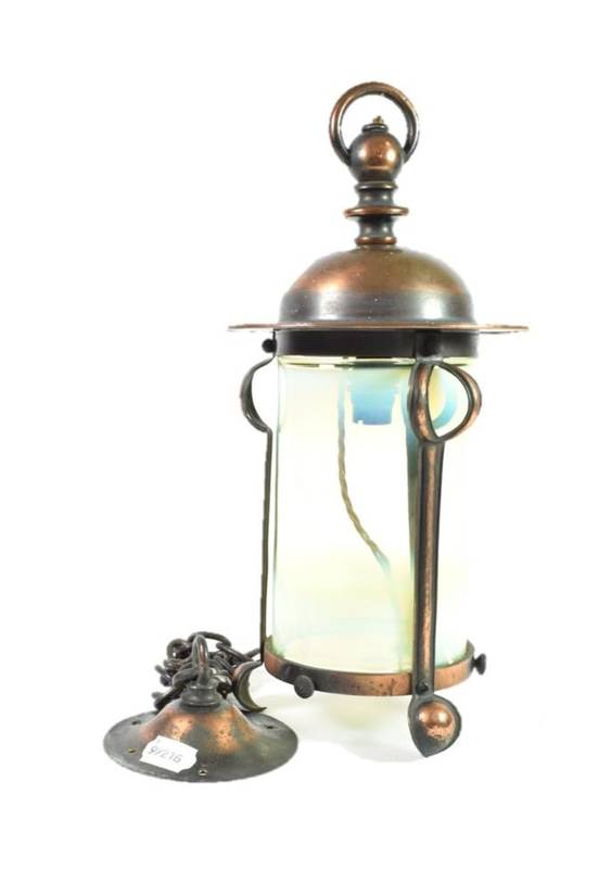 Lot 250 - An Arts & Crafts Copper Lacquer Hall Lantern, the domed top above a stylised frame with...