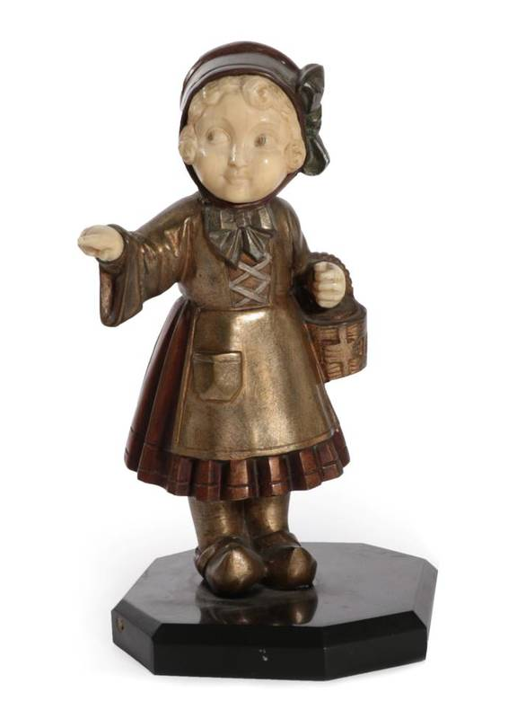 Lot 254 - An Art Deco Bronze and Ivory Figure, modelled as a Dutch girl, holding a basket in one arm and...