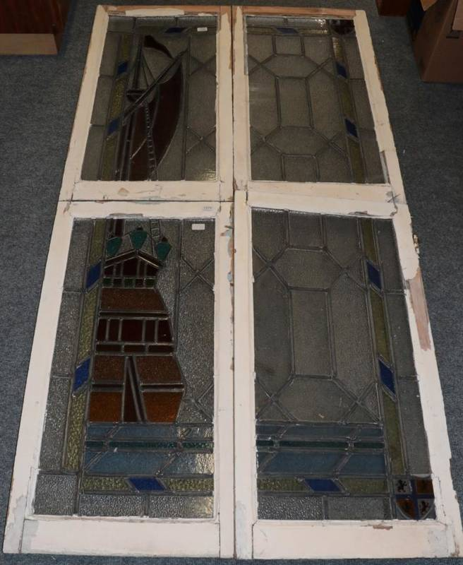 Lot 259 - A Set of Four Stained Glass Window Panels, forming a scene of a galleon at sea within blue and...