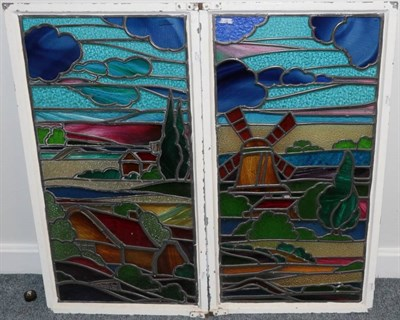 Lot 260 - Two Stained Glass Windows, depicting a windmill and cottage in a pastoral landscape, 90cm by 48cm