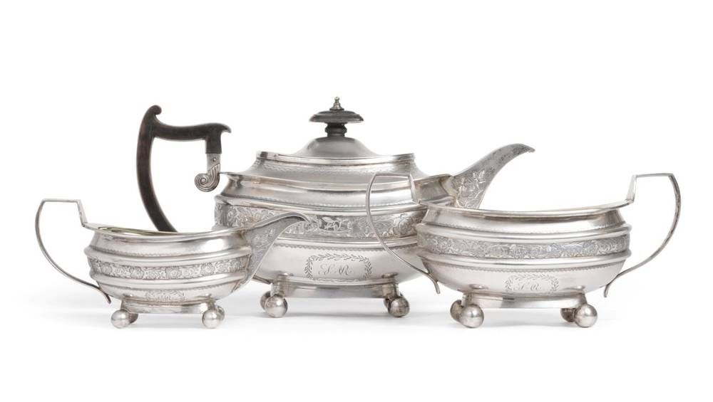 Lot 43 - A George III Silver Three Piece Tea Service, Robert & Samuel Hennell, London 1810, squat oval, with