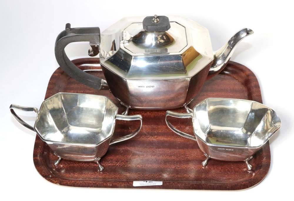 Lot 42 - A three piece silver tea service, Harrison Fisher & Co, Sheffield 1945, the teapot 25.5cm long,...