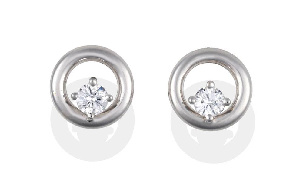 Lot 2030 - A Pair of 18 Carat White Gold Diamond Earrings, a round brilliant cut diamond claw set and...