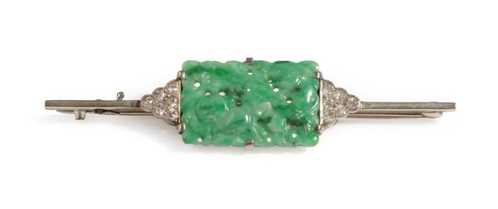 Lot 2 - An Art Deco Jade and Diamond Bar Brooch, the oblong pierced jade depicting fruits, with a...