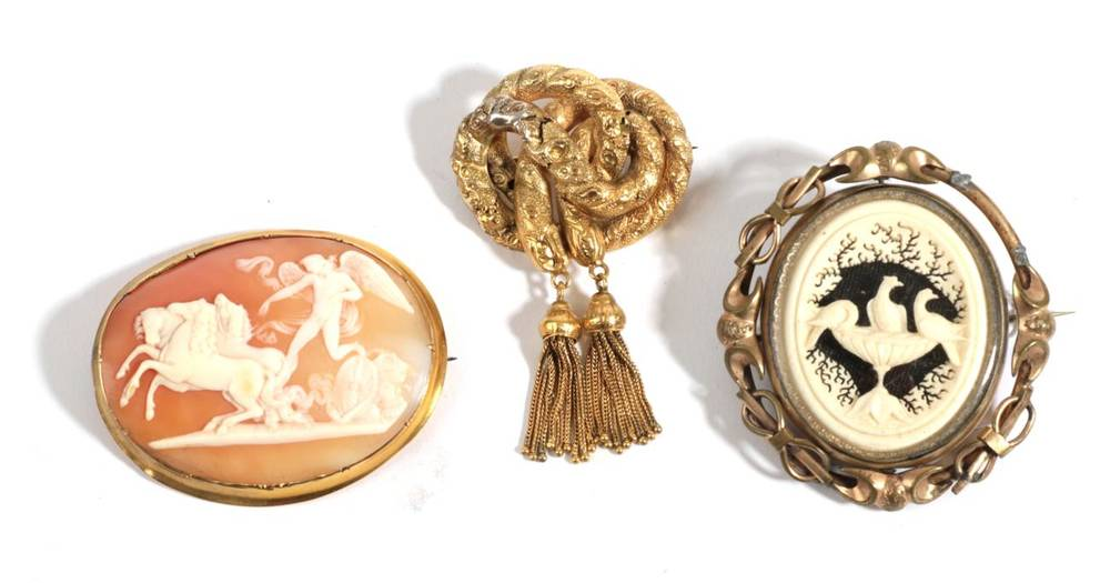 Lot 24 - A Carved Ivory Brooch, depicting three birds at a bath, in a swivel frame (a.f.), A Victorian...