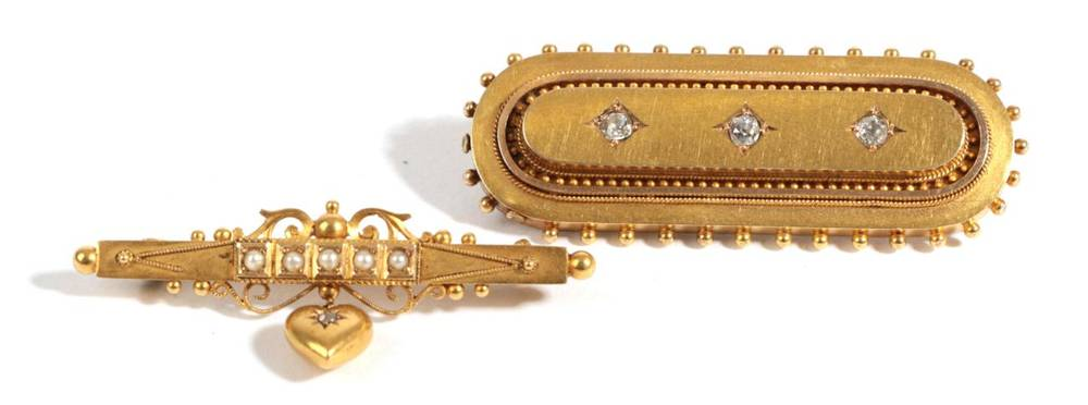 Lot 25 - A Victorian Brooch, of oblong form with beaded outer edge and plaited hair encased, length 5cm...
