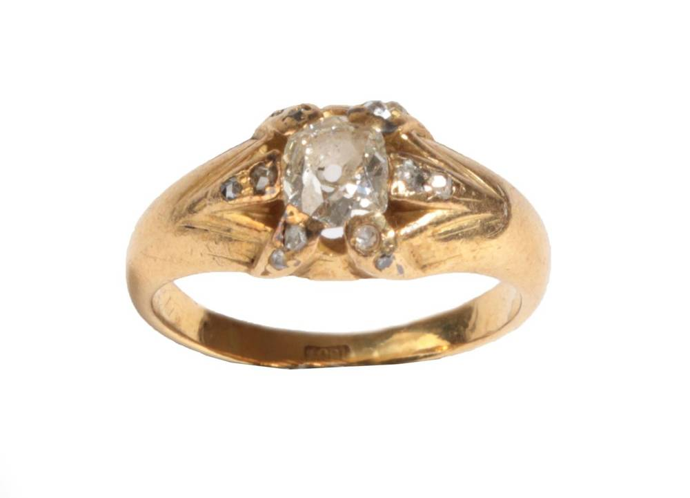 Lot 26 - A Diamond Ring, an old mine cut diamond held in six yellow claws, each inset with two rose cut...