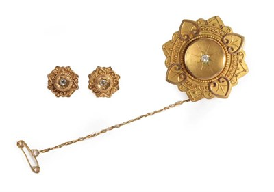 Lot 29 - A Victorian 15 Carat Gold Brooch and Earring Set, the brooch with a central old cut diamond...