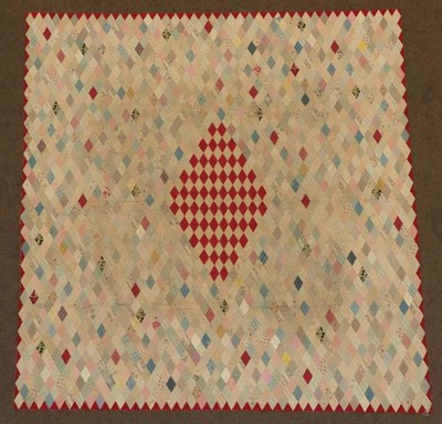 Lot 2015 - Late 19th Century Diamond Patchwork Quilt, with central large diamond enclosing smaller turkey...