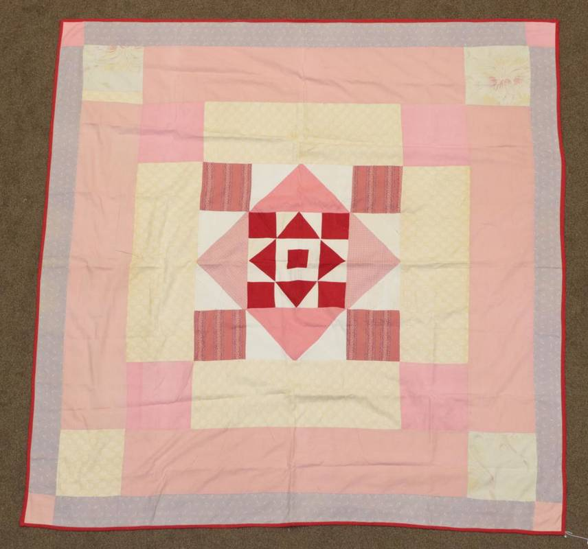 Lot 2022 - 19th Century Patchwork Cover, with a central turkey red and white square comprising squares and...