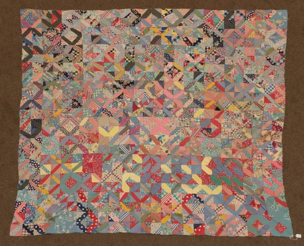 Lot 2042 - Circa 1930 African American Unfinished Patchwork Coverlet, incorporating feed sacks, shirting...