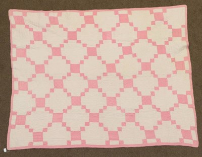 Lot 2046 - Circa 1920s Pale Pink and White Cotton Welsh Quilt, Irish chain pattern patchwork to one side,...