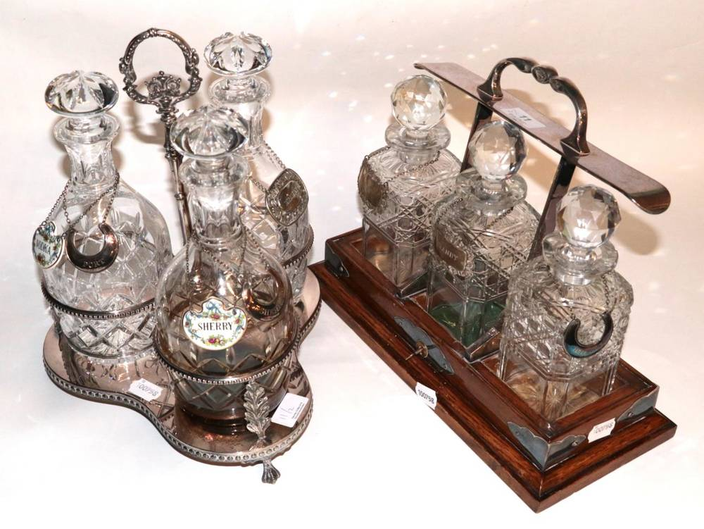Lot 11 - A silver plated three bottle decanter stand, with cut glass decanters; and a three bottle...