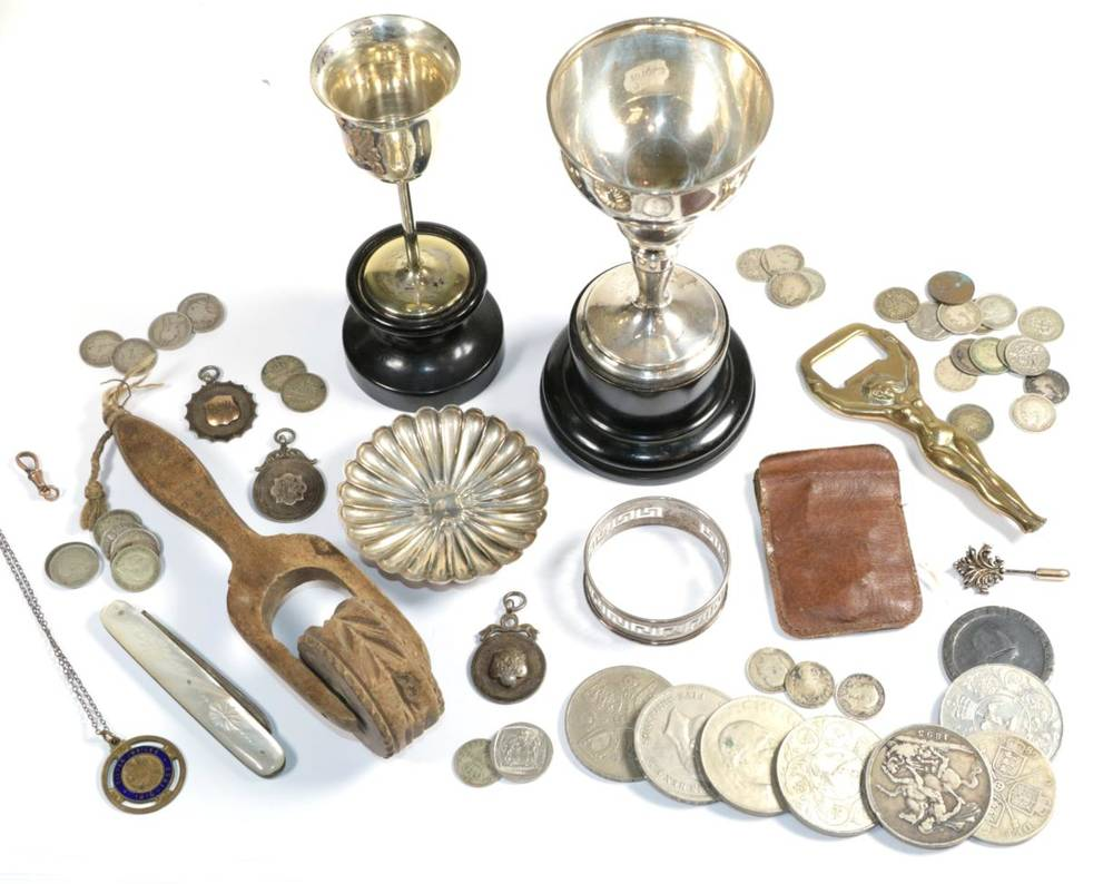 Lot 90 - A silver trophy cup; a quantity of coins; a silver pin dish; silver medals; silver napkin ring;...