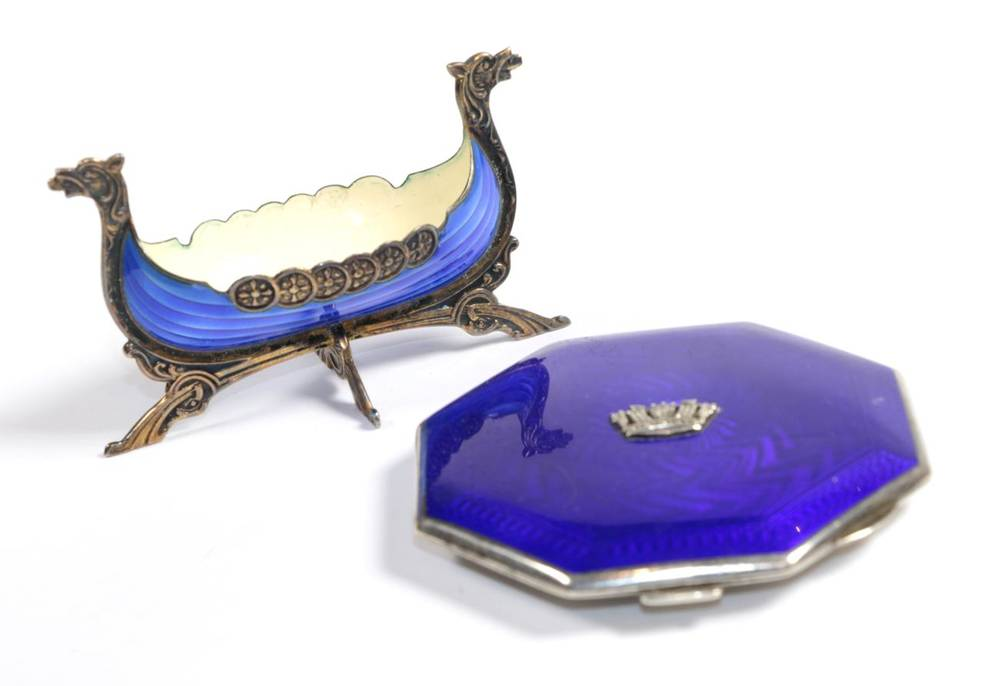Lot 99 - A silver and enamel lady's powder compact with Naval crown; and a Norwegian enamel Viking boat...