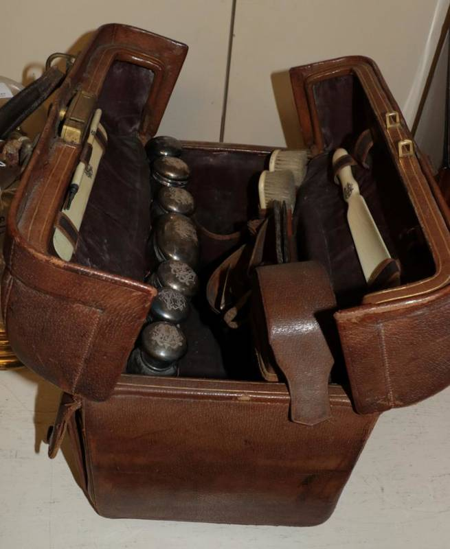 Lot 179 - A Victorian leather travelling dressing case with silver mounted and ivory fittings, Frederic...
