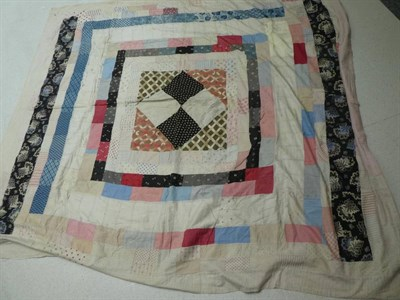 Lot 1017 - Small early 20th century patchwork coverlet, comprising 2cm squares overall in coloured and printed