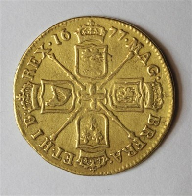 Lot 4 - Charles II (1660-1685), Guinea, 1677, second bust right, rev. crowned cruciform shields,...