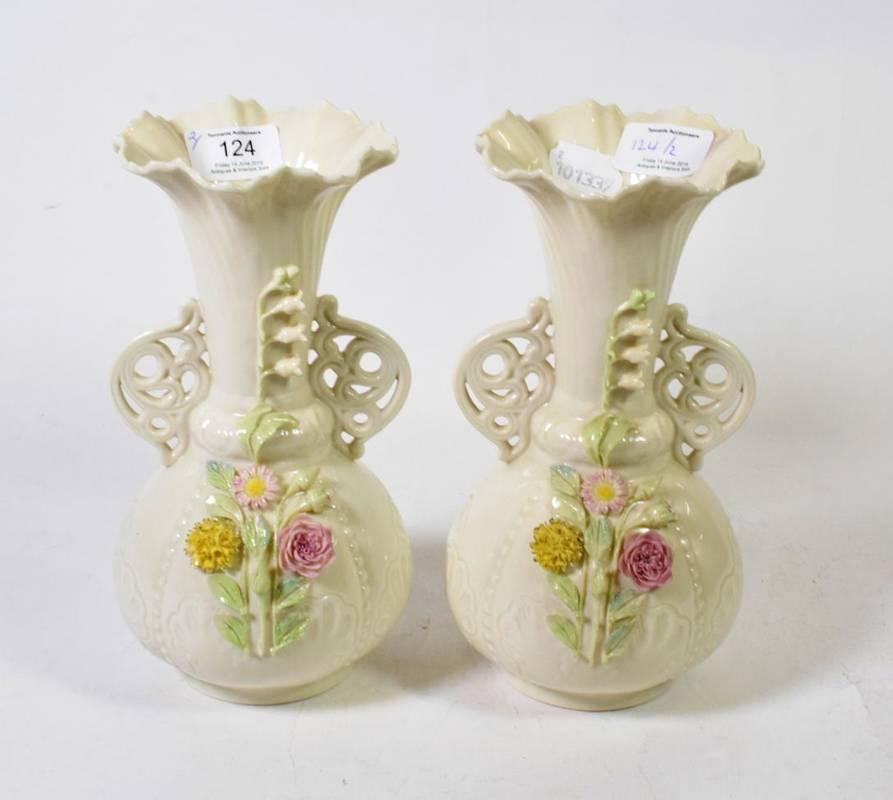 Lot 124 - A pair of Belleek twin handled vases