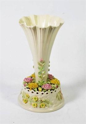 Lot 125 - A Belleek trumpet shaped centrepiece vase