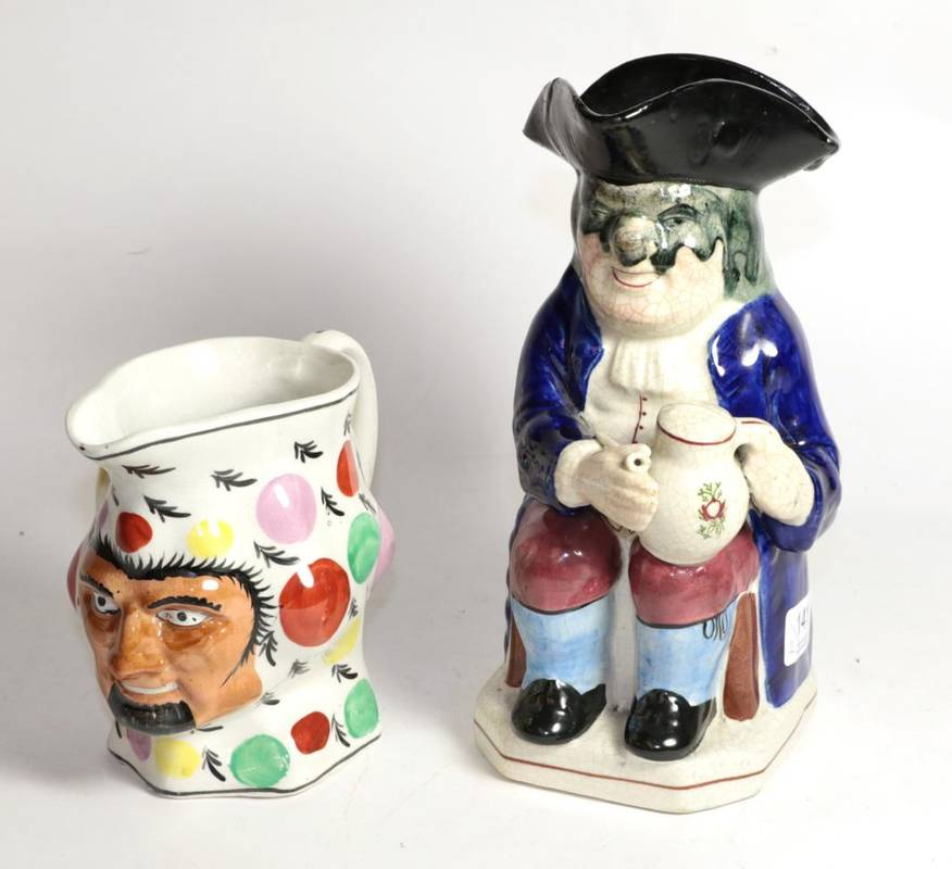 Lot 141 - A 19th century Toby jug together with another 19th century jug (2)