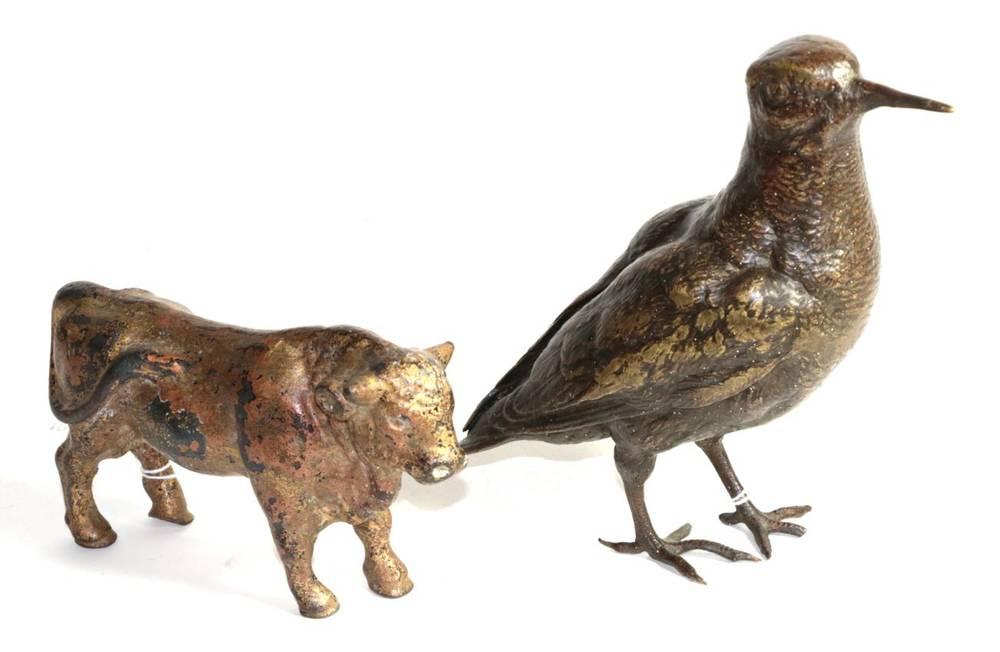 Lot 142 - A bronze model of a bird; and a cast metal model of a bull