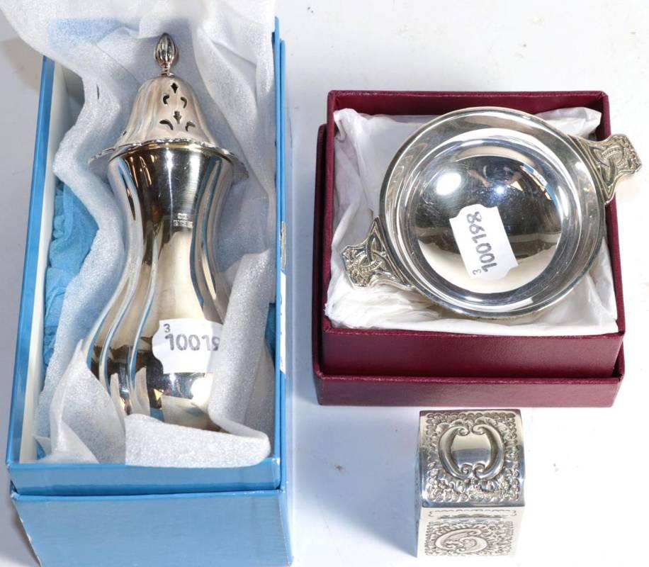 Lot 143 - A silver sugar caster, John Rose, Birmingham 1964, in a Garrard box; a repousse decorated miniature
