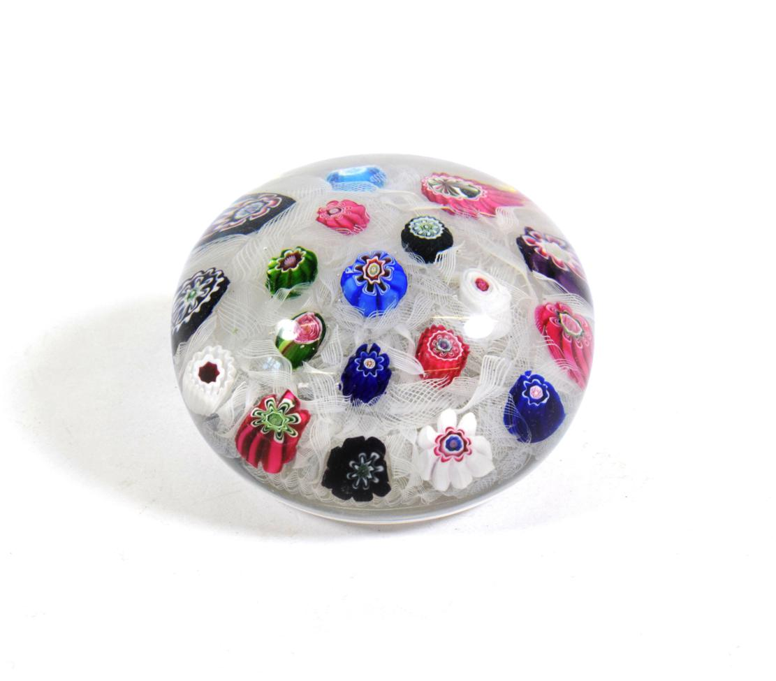Lot 503 - A Clichy Spaced Millefiori Paperweight, circa 1850, set with nineteen canes on a white gauze...