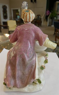Lot 507 - A Chelsea Porcelain Figural Sweetmeat Dish, circa 1755, as a seated Turk holding a shell, on a...