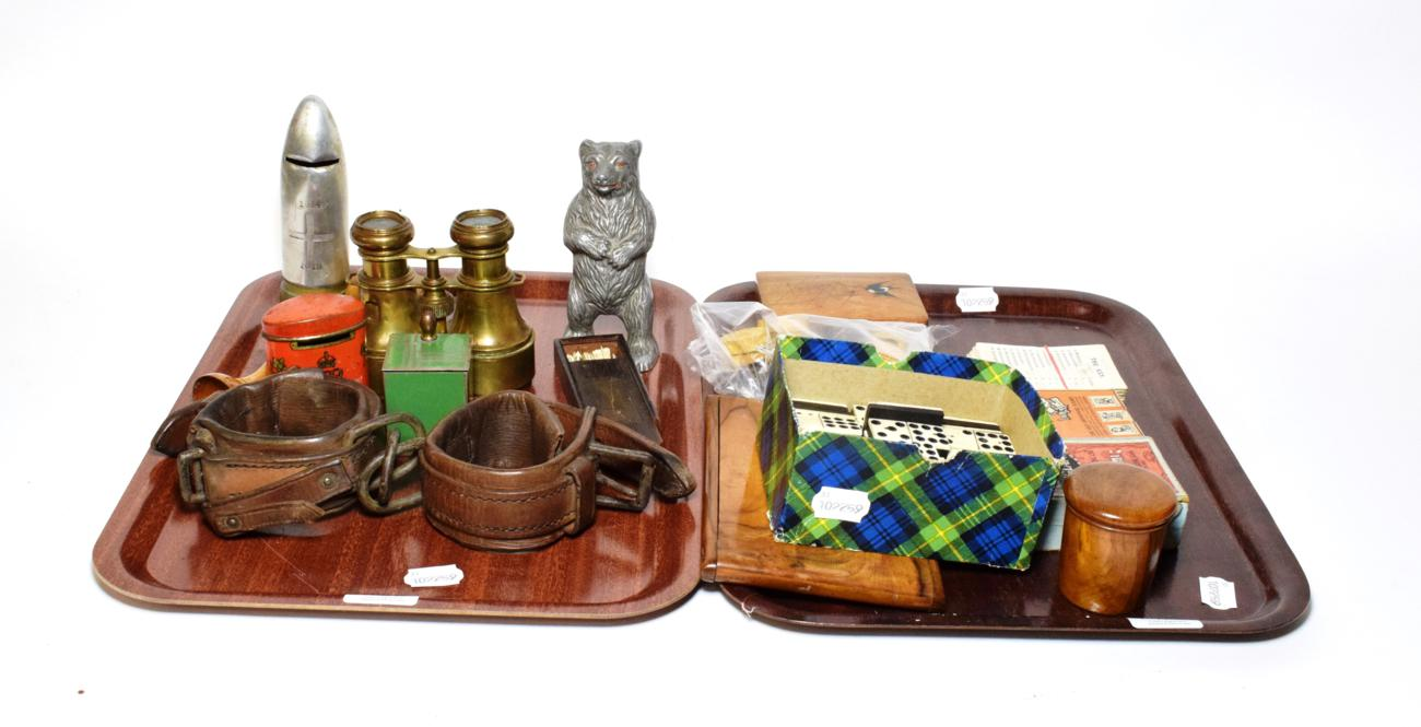 Lot 8 - Two trays of games including nine dominoes, bilboquet, spillikens, two money boxes, cards, shackles