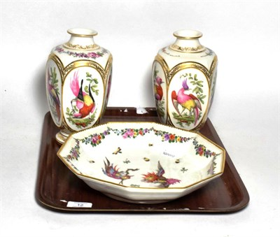 Lot 12 - A pair of Continental 18th century style vases and a similar dish (3)