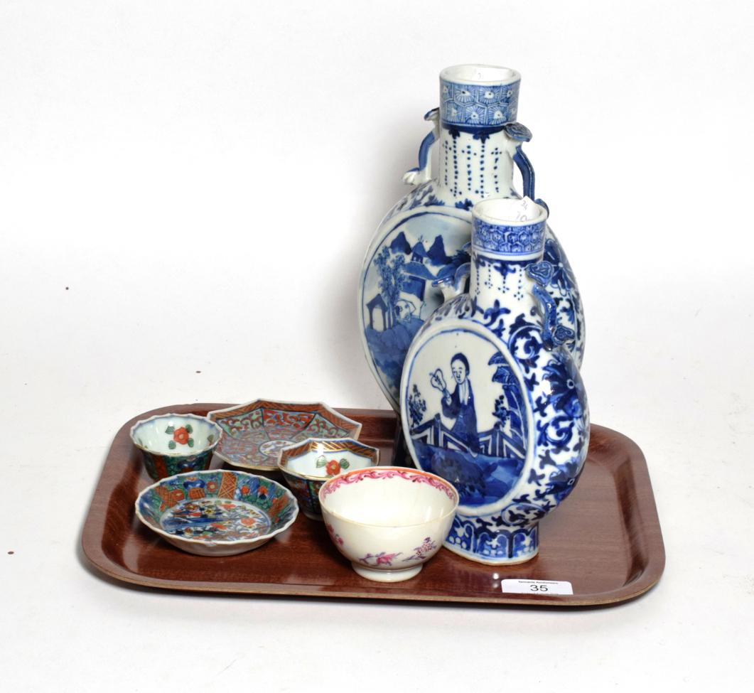 Lot 35 - Two Chinese blue and white porcelain twin handled moon flasks, an 18th century tea bowl, two...