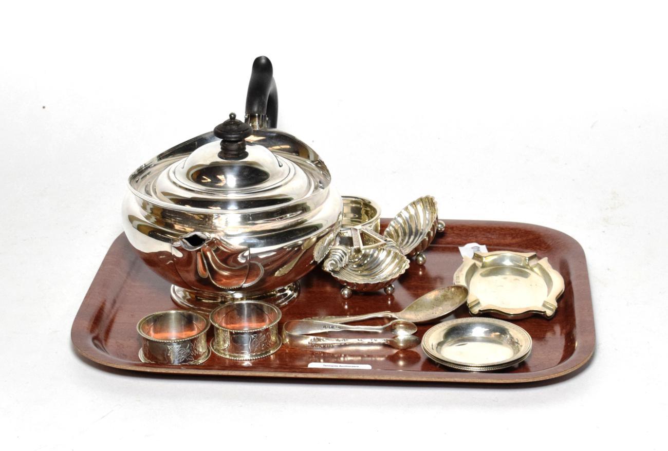 Lot 36 - Silver; teapot Sheffield, 1897, tea strainer, Birmingham, 1938, pair of ashtrays, Birmingham, 1938