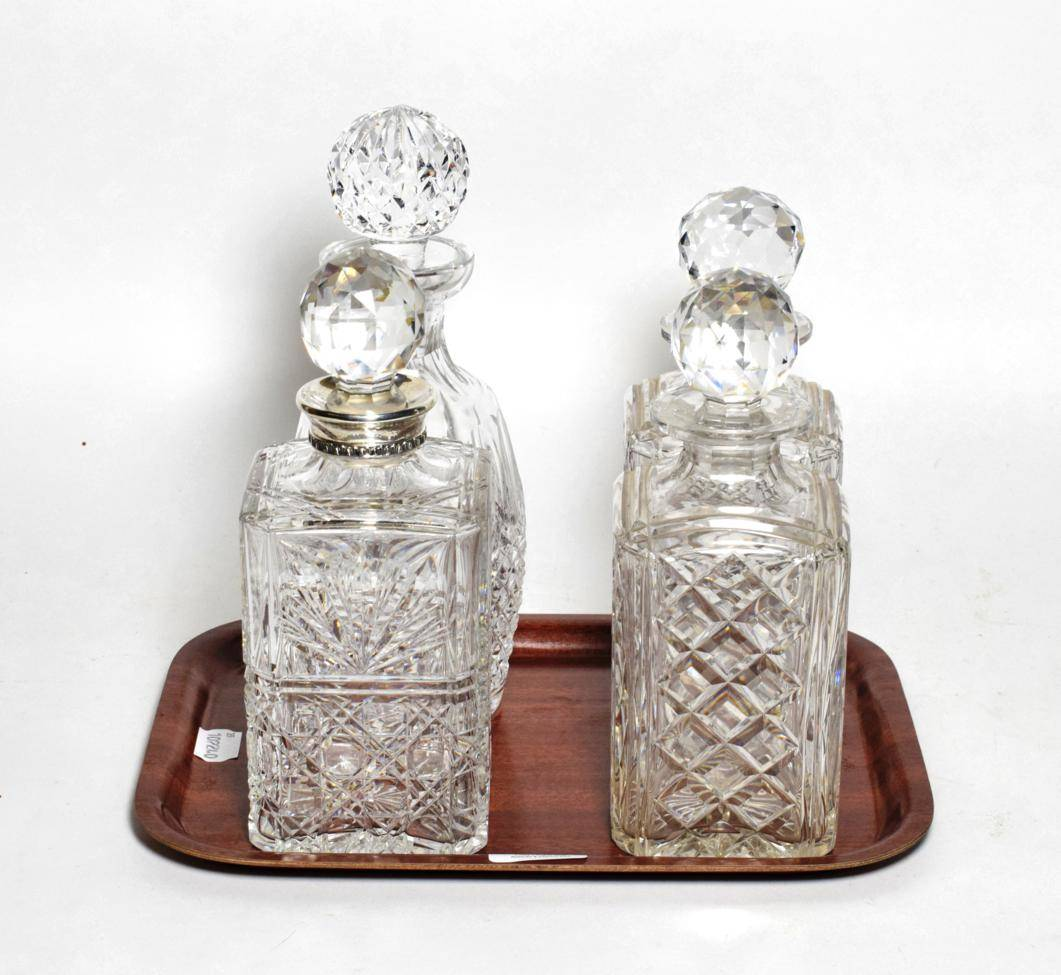 Lot 39 - A silver mounted decanter stamped Aspreys London, a Waterford decanter and a pair of decanters