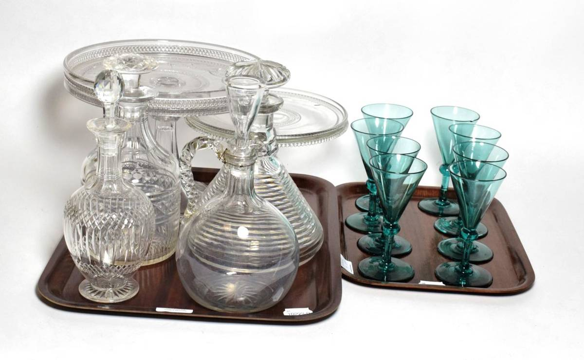 Lot 40 - Two tazzas, a port decanter, three other decanters and a set of eight 19th century green glass...
