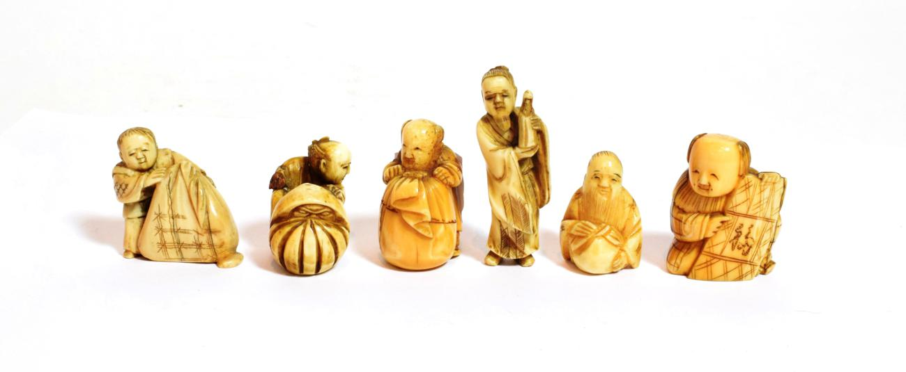 Lot 122 - A collection of six Japanese ivory figural netsuke, Meiji period (1868-1912) various including...