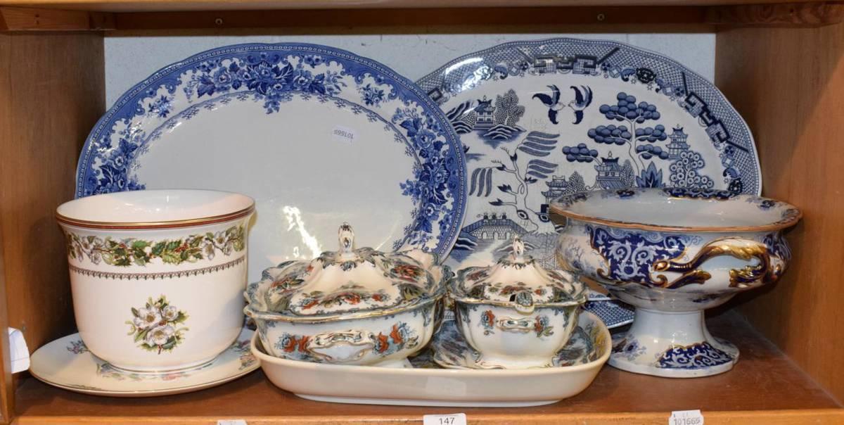 Lot 147 - A shelf of ceramics including Ironstone tureens, blue and white meat plates, Minton cache pot etc
