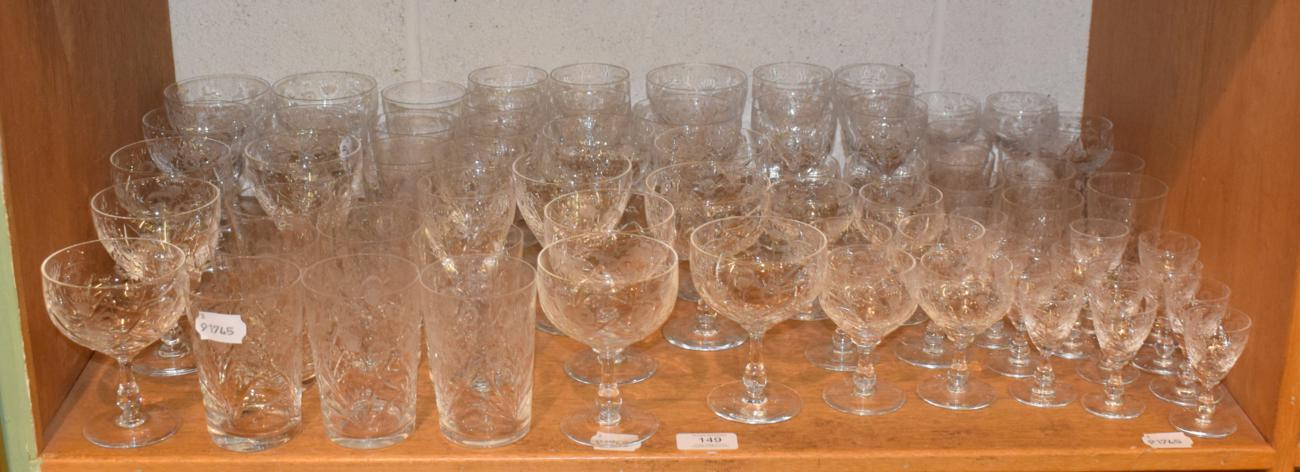 Lot 149 - A service of drinking glasses engraved with flowers, seventy pieces